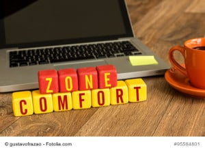 Comfort Zone written on a wooden cube in office desk
